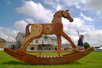 Four-year-old Lauren Batty welcoming giant sculptures to the Great Yorkshire Show