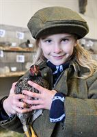 Six year old Laura Beard from Wakefield, a young exhibitor in the Poultry Section