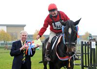 Alan Evans of Monk Fryston, York on Gulliver, winner of the Senior Novice section of the finals of the Northern Show Cross Series receiving his award from Show Director, Bill Cowling