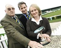 Mrs Jane Gray with the Tye Trophy with former president Raymond Twiddle and Nigel Pulling, Chief Executive of the Yorkshire Agricultural Society