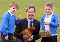 7 year old Jack Castle and 8 year old Ellie Flintoft of Starbeck Community Primary School with the Yorkshire Agricultural Society's Chief Executive, Nigel Pulling at the breakfast event