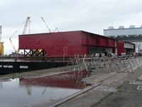 Flight deck modules loaded onto a barge at the Port of Liverpool