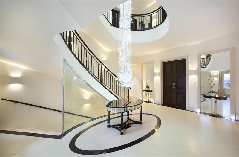Grand art deco inspired entrance with custom made chandelier isg medium resolution aloadofball Choice Image