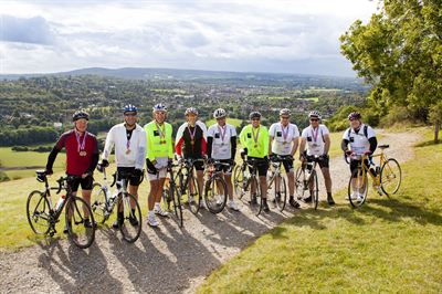 The team makes it to the top of the infamous Box Hill wearing the Going Beyond Gold Medals