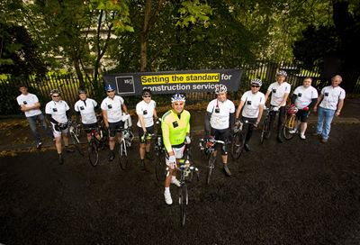 The team lines up close to Putney Bridge at the start of the 'Going Beyond Gold' challenge