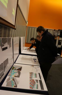 Visitors review visualisations and key project information at the Open Day event