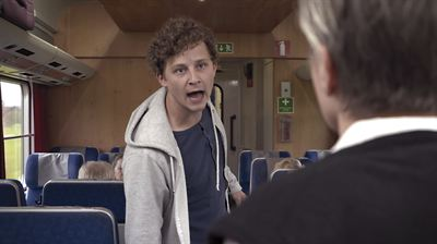 Hotfull situation på tåg Foto Houdini