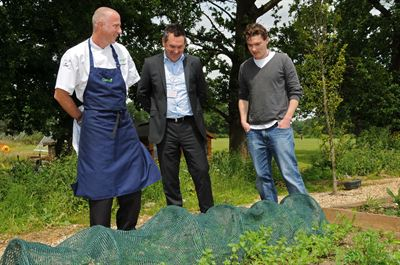 Cucina Executive chef Ian Morgan with company MD Steve Quinn and Ash Mair at Harefield's school allotment