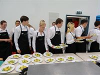 Harefield Academy catering students serving the Academy dinner