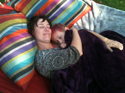 Shayla and her mom snuggling in her new hammock.