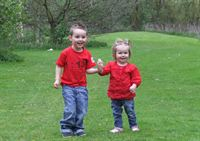 Pictured is Logan Whiteley and little sister Darcie celebrating Red Day with themed outfits