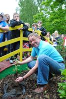 Paul Kitson from Cool Milk planting trees with staff and pupils at Queen's Park School in Lincoln as part of the Woodland Trust Jubilee Woods project.
