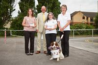 From L-R: St Barnabas Hospice's Rachael Hewitt, Chairman of Lincoln Business Club Richard Hare and Denise Taylor and Pauline Shepherd from Hearing Dogs for Deaf People with Merlin the dog
