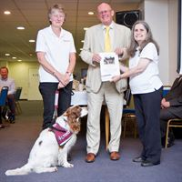 Lincoln Business Club Chairman Richard Hare presenting a cheque for £250 to Pauline Shepherd (left) and Denise Taylor from Hearing Dogs for Deaf People
