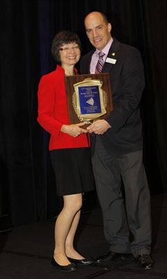 Dr. Penelope Suter accepting A.M. Skeffington Award from COVD President Dr. David Damari