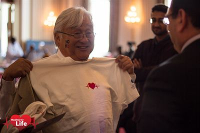 U.S. Congressman Mike Honda (Democrat from California) talks with volunteers at the Muslims for Life Blood Drive on September 13, 2012 at the Cannon Caucus Room
