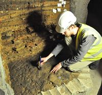 Ian Milstead Lead Archaeologist from YAT cleaning Roman Road beneath York Minster