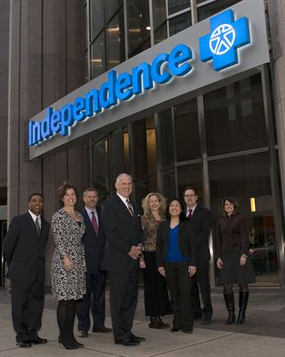 Independence Blue Cross president and CEO Daniel J. Hilferty unveils the company's new building signage