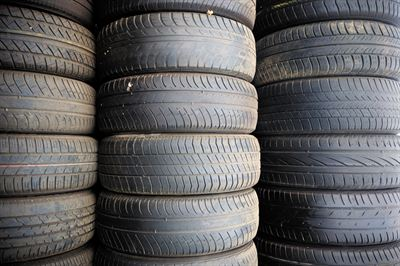 A stack of part worn tyres
