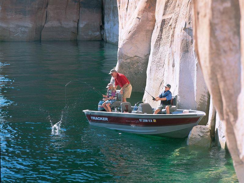 Grandfather with children fishing lake powell aramark for Lake powell fishing