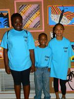 KID Campers showing off their artwork