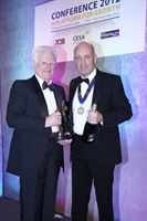 Eddie Moffat, left, accepts the Outstanding Contribution Award from Nick Oryino