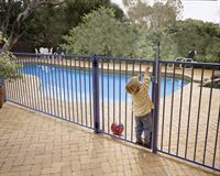 Boy at Pool Fence