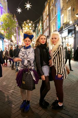 Shoppers enjoy the Carnaby Shopping Party tonight in London s Carnaby Street W1