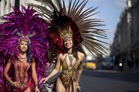 In Regent Street carnival dancers Jennice Crystal Price and Lolo Page from Trinidad and Tobago wearing costumes by Bacchanalia warm up for InsureandGo The World on Regent Street