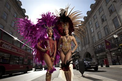 In Regent Street carnival dancers Jennice Crystal Price and Lolo Page from Trinidad and Tobago wearing costumes by Bacchanalia