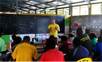 A Volunteer Minister of the South Pacific Goodwill Tour covers information to improve teacher and student performance at a workshop at Visale Primary School.