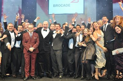 Softcat employees celebrate with Jack Dee upon winning Reseller of the Year