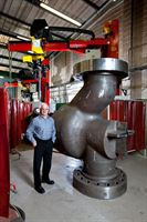 Arc Energy's Alan Robinson with a Rotating Head machine