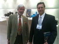 Jean-Michel Cousteau pictured with Dave Gatzke, Carlson Hotels Worldwide, in Concept Amenities booth at IHM&amp;RS 2011
