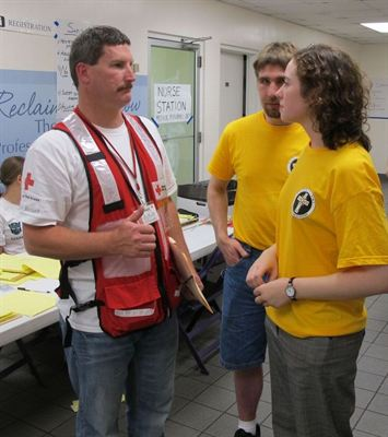 Scientologist Julie Brinker (right), helping coordinate activities  at a shelter after the Nashville flood of May 2010.