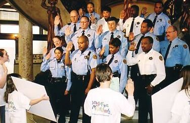Scientologist Julie Brinker (far left) at 16, swearing in the  St. Louis Narcotics Division as Drug-Free Marshals
