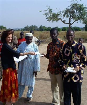 Scientologist Catherine Remise distributes copies of the nonreligious, common-sense moral code  The Way to Happiness in the village of Diokeli, Mali.